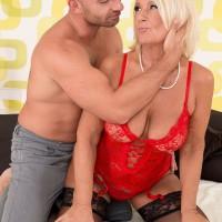 Stocking clad over 60 blonde MILF Regi tit fucking large cock in lingerie