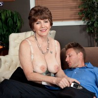 Naughty 60 plus MILF Bea Cummins seducing younger stud in office for sex