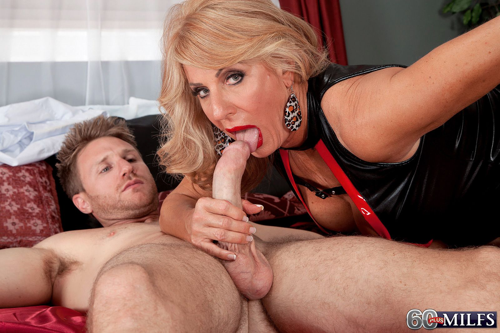 Over 60 MILF pornstar Phoenix Skye jerks off cock in sexy outfit and ...