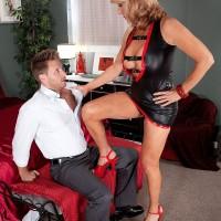 Over 60 MILF pornstar Phoenix Skye jerks off cock in sexy outfit and heels