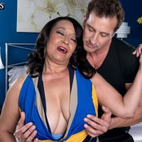 Busty 60 plus MILF Rochelle Sweet getting frisky with younger man