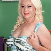 60 plus MILF model Angelique DuBois bares large mature tits before giving bj