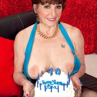 Busty older babe Bea Cummins blows out the candles for her 70 MILF birthday