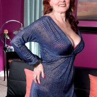 Over 60 redheaded escort Katherine Merlot serving up big saggy tits and sex