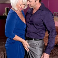 Over 60 MILF Jeannie Lou exposing pussy in crotchless nylons for younger man