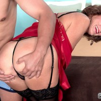 Petite 60 plus MILF Sydni Lane stripping down to nylons and lingerie before sex