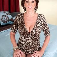 Over 60 solo model Sydni Lane posing for non nude pics in cougar print dress