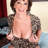 Over 60 solo model Sydni Lane posing for non nude pics in cougar print dress