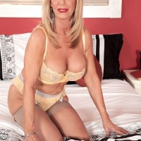 Over 60 escort Phoenix Skye giving a sexy massage in nylons and garters