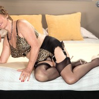 Short haired GILF Bea Cummins strutting in garters, nylons and high heels