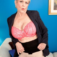 Over 60 MILF Lin Boyde exposing big tits before giving handjob in office