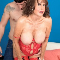 Sexy granny Jacqueline Jolie lets her big natural tits loose for younger man