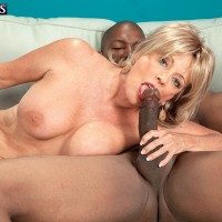 Busty blonde 60 plus MILF Lexi McCain giving big black cock blowjob in jeans