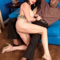 Sexy granny Gillian Sloan shows her shaved pussy with help from black toy boy