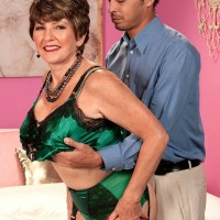 Stocking and garter clad over 60 MILF Bea Cummins having big mature tits freed