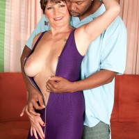 Mature lady Bea Cummins having sex with a black bull in front of cuckold