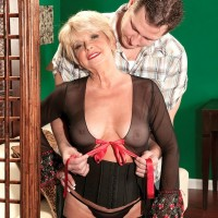 Classy short haired blonde 60 MILF DeAnna Bentley riding younger man's cock