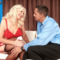 Blonde 60 plus MILF Summeran Winters getting naughty in nylons and garters