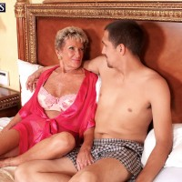 Leggy over 70 granny Sandra Ann receiving oral sex from young stud