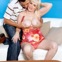Busty MILF over 60 Lola Lee giving long cock a blowjob in high heels