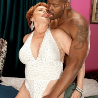 Horny 60 plus MILF Leah L'Amour seduces a younger stud in the sauna before giving a BJ