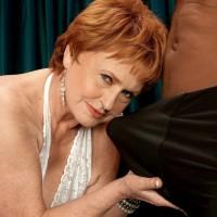 Naughty 60 MILF model Valerie deepthroating a big black cock