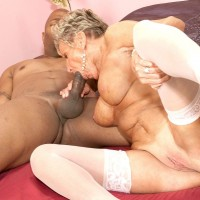 Busty 70 plus GILF Sandra Ann giving BBC interracial bj in panties and stockings