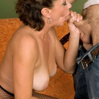 Horny granny Jamy Nova bares her tan lined tits before giving a boy a blowjob