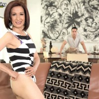 Petite Asian granny Kim Anh stripping down to revealing lingerie for younger man