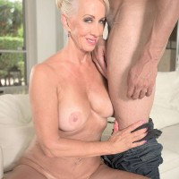Blond grandma Julia Derriere uncovering adorable boobs in denim jeans before interracial MMF threeway