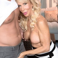 Busty blonde granny Erica Lauren having erect nipples sucked and pussy licked