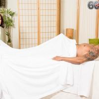 Topless Asian masseuse Kim Anh giving big cock handjob before riding on top