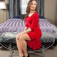 60plusmilf.com model Mona posing in pantyhose and dress before hardcore sex