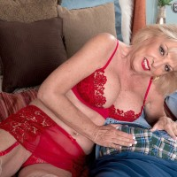 Big-chested fair-haired granny in nylons and lingerie giving big wood breast banging and blowjob