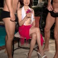 Busty Asian granny Kim Nah giving huge cocks handjobs and blowjobs outdoors