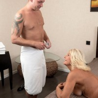 Blonde 60 MILF rolling off nylons before having bare ass massaged with oil