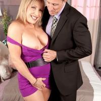 Blonde granny pornstar Luna Azul flashing panties before baring big natural tits