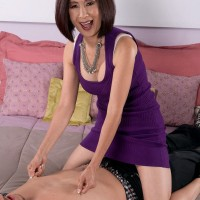 Tiny Asian grandmother Kim Anh pinching younger man's nipples during foreplay