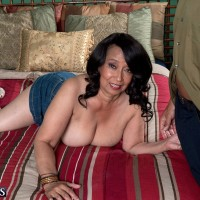 Mature MILF over 60 Rochelle Sweet freeing huge boobs in denim skirt