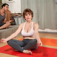 Hot granny in yoga clothes having large natural boobs exposed by instructor