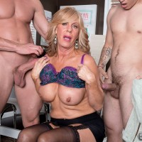 Leggy blonde granny in black stockings jerking off 2 big dicks at the same time