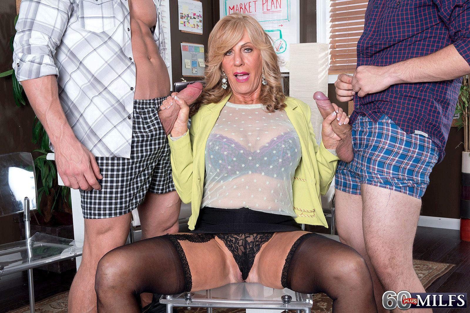 Leggy blonde granny in black stockings jerking off 2 big dicks at the same time
