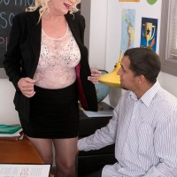 Leggy blonde MILF over 60 teacher in nylons fucking student's big dick in classroom