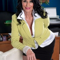 Stocking and skirt clad 60 plus MILF Rita Daniels stripping down to lingerie