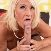 Blonde 60plusMILFs.com model Regi baring large natural tits before giving bj