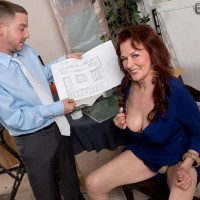 Mature redhead Katherine Merlot unleashing large saggy tits in office to seduce man