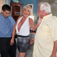60 plus blonde MILF Scarlet Andrews having big tits exposed in font of cuckold