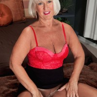 Stocking and lingerie adorned 60 plus MILF Madison Milstar giving big cock handjob
