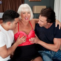 Pantyhose garbed mature pornstar Jeannie Lou jerking cock in MMF threesome