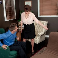 Nylon and skirt clad mature woman Bea Cummins seducing younger man in office